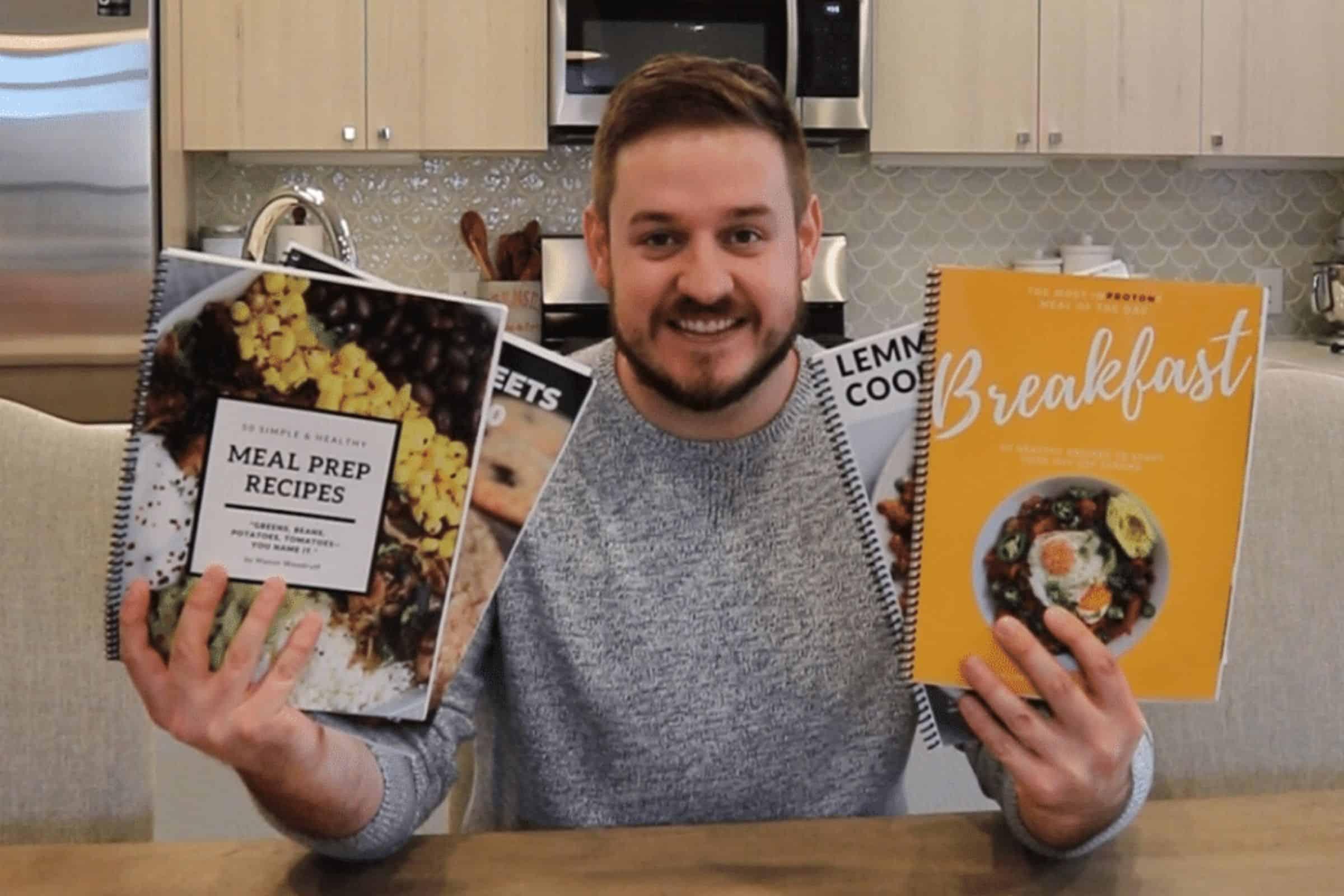 mason woodruff holding hard copy cookbooks