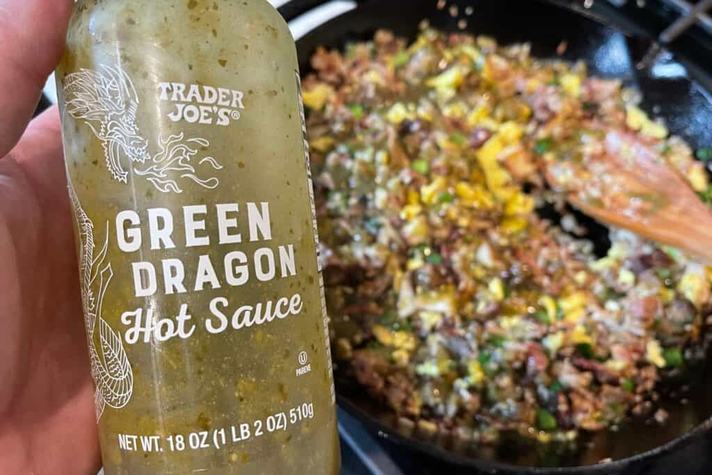 Trader Joe's green dragon sauce going in the brisket fried rice