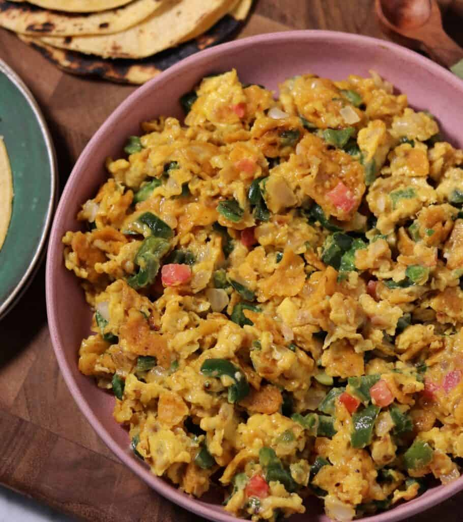 cooked Tex-Mex migas in a large bowl beside charred tortillas