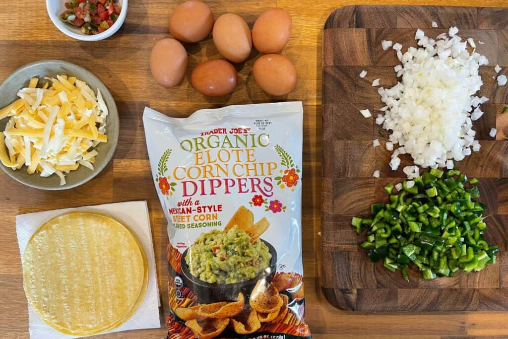diced onion and peppers, Trader Joe's corn dippers, eggs, pico de gallo, corn tortillas, and shredded cheese