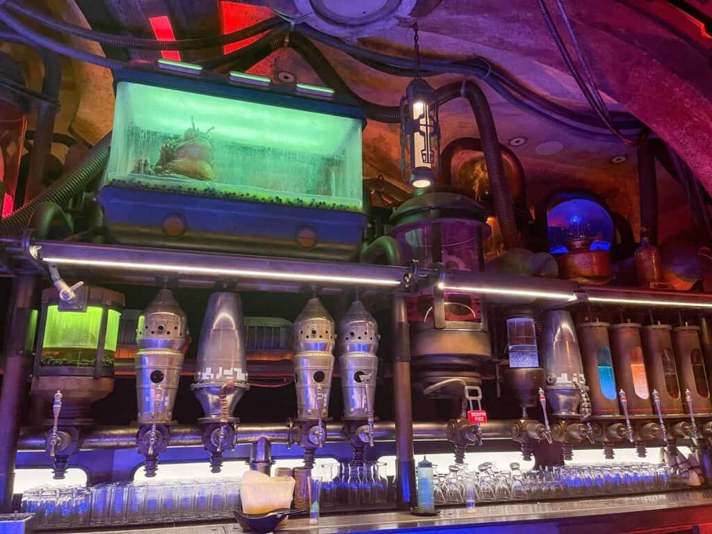 at the bar inside Oga's Cantina