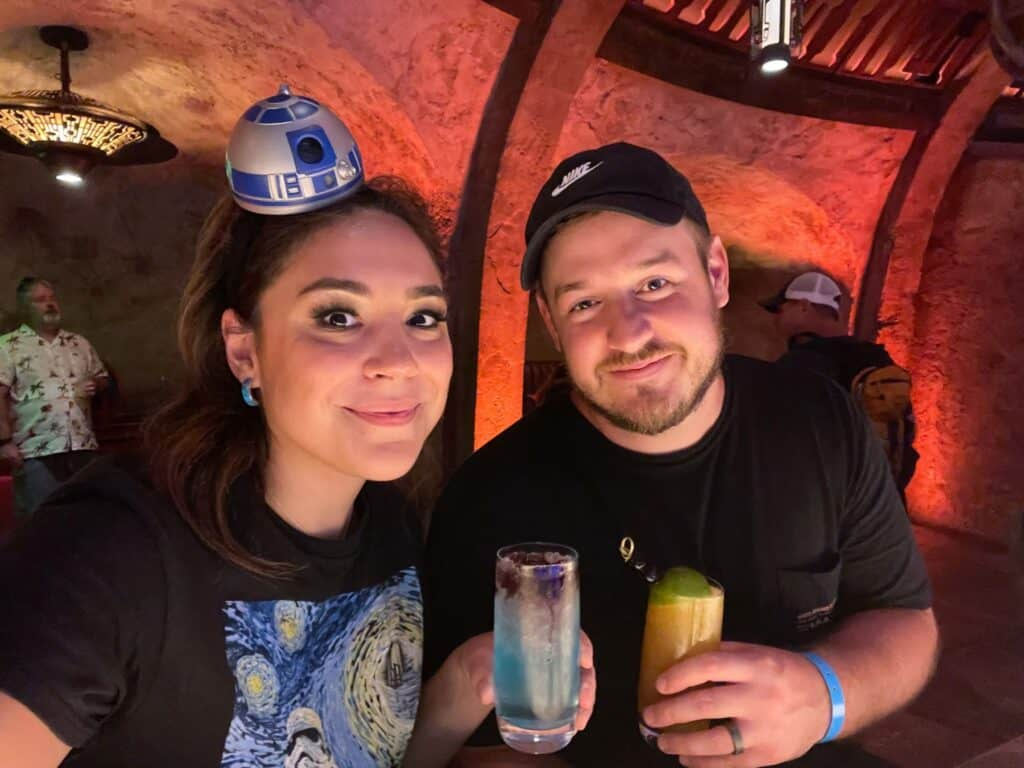 mason and vanessa with drinks from Oga's cantina