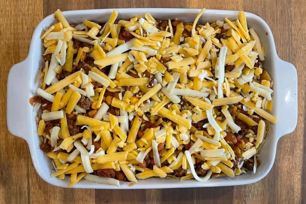 shredded cheddar jack on top of the filled baking dish before baking