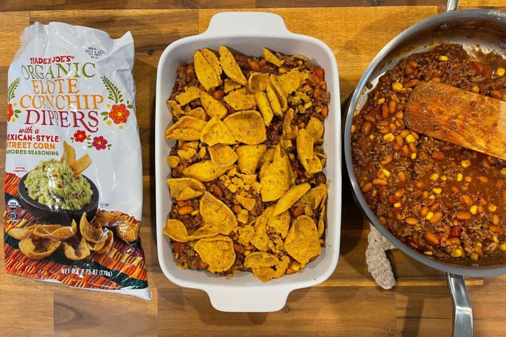 Trader Joe's elote corn chip dippers in a baking dish with the taco pie filling